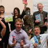 Photo of authors holding books up